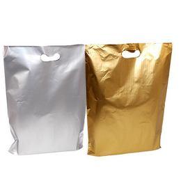 Nagy Ajándéktasak Arany és Ezüst Színben -  35 cm x 50 cm, 50 db/csomag